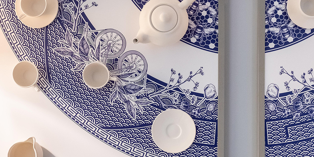 HOTEL INDIGO | MANCHESTER - TL Contracts supplied over 2500 individual items to IHG's stunning hotel in Manchester. We designed and manufactured over 800 bespoke ceramic tea cups for the 'Tea Rooms' and our graphics team set to work creating the Manchester Willow Pattern framed art.